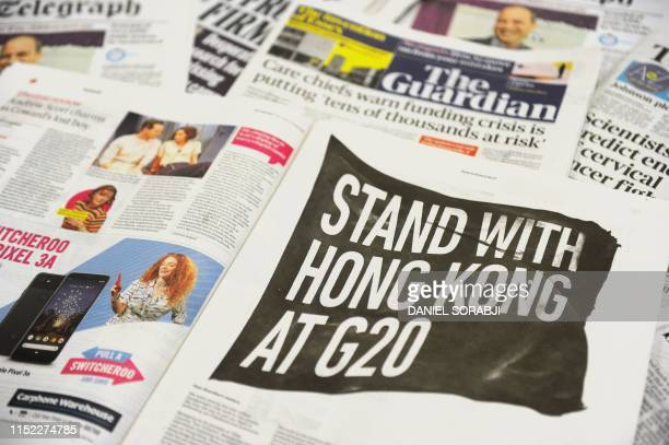 An arrangement of newspapers photographed as an illustration in London on June 27 shows a fullpage advertisement taken out in the UK daily The...