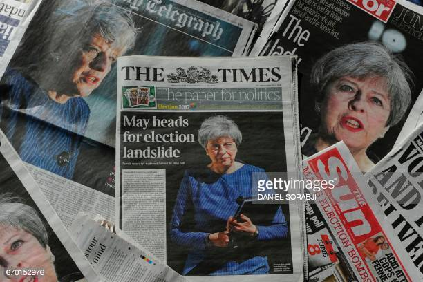 An arrangement of newspapers pictured in London on April 19 as an illustration shows the front pages of the UK daily newspapers reporting on British...