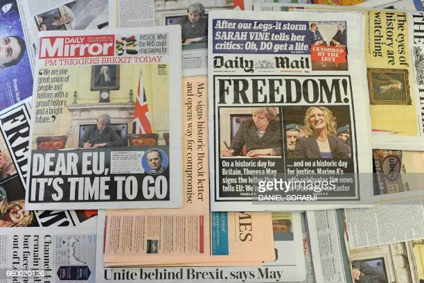 An arrangement of newspapers pictured in London on March 29 as an illustration shows the front pages of the UK daily newspapers reporting on British...