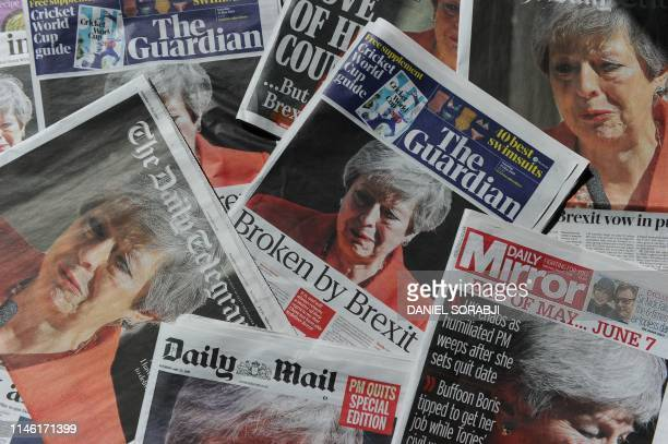 An arrangement of UK daily newspapers photographed as an illustration in London on May 25, 2019 shows front page headlines reporting on the...