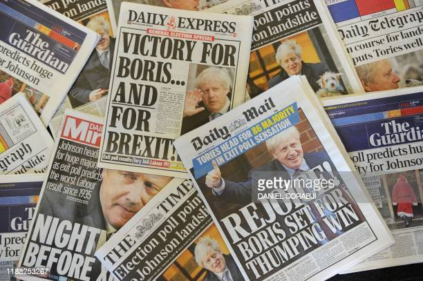 An arrangement of UK daily newspapers photographed as an illustration in London on December 13, 2019 shows front page headlines reporting on the...