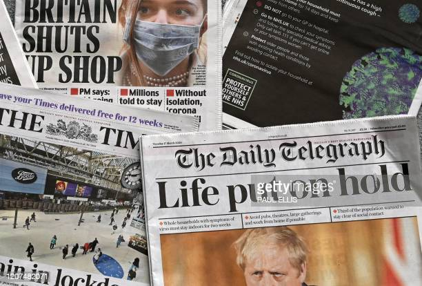 An arrangement of UK daily newspapers photographed as an illustration in Liverpool on March 17 shows front page headlines and a back page NHS...