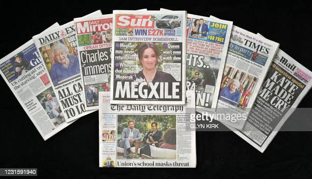 An arrangement of UK daily newspapers photographed as an illustration in Brighton on March 8 shows front page headlines reporting on the story of the...