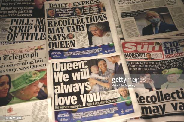 An arrangement of UK daily newspapers shows front page headlines reporting Queen Elizabeth's respond over the interview given by the Duchess of...