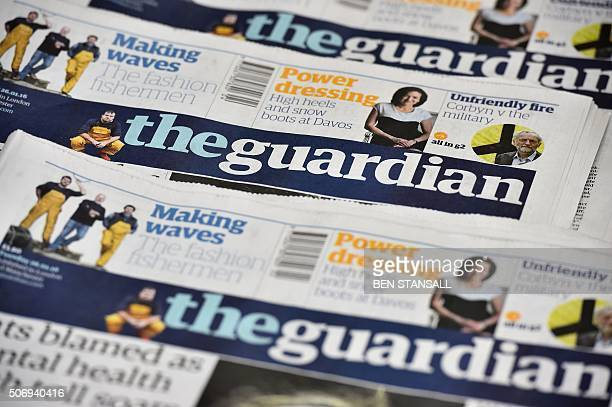 An arrangment of Guardian newspapers is photographed in an office in London on January 26 2016 The Guardian newspaper is to cut running costs by 20...
