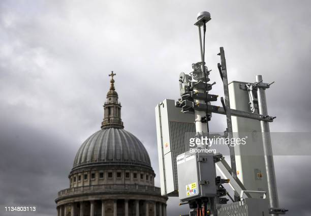 An array of 5G masts installed on a rooftop overlooking St Paul's Cathedral by EE the wireless network provider owned by BT Group Plc during trials...