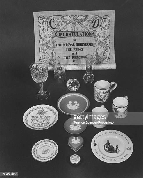An array of commemorative gifts celebrate the birth of Prince William Wedgewood and china plates mugs and boxes crystal goblet bell and vase