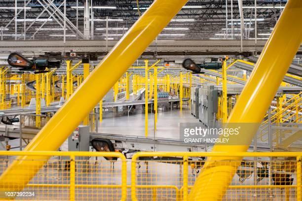 An array of conveyor belts snakes through tThe Amazon Fulfillment Center during a tour September 21 2018 in Kent 0Washington