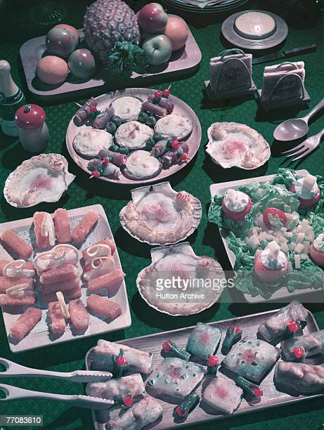 An array of food laid out for a picnic circa 1955