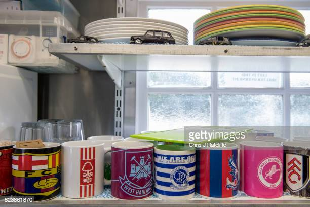 An array of football club mugs that belong to the regular Hackney Carriage taxi drivers who visit the Warwick Avenue Cabmen's Shelter are stored on a...