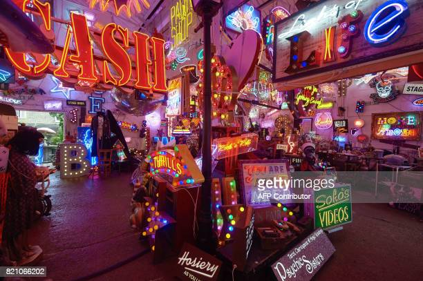 An array of neon lights and signs is displayed inside God's Own Junkyard gallery cafe and workshop in Walthamstow east London on July 8 2017 Whether...