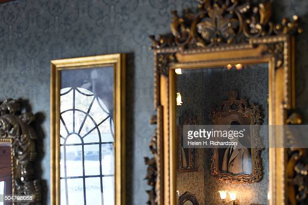 An array of old mirrors and pictures of previous owners are mounted on the walls on the main staircase in the Stanley Hotel on January 12 2016 in...