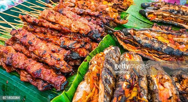 an array of skewered pork meat and grilled fish - filipino culture stock pictures, royalty-free photos & images