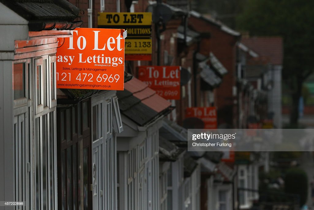 An array of To Let and For Sale signs protrude from houses in the Selly Oak area of Birmingham on October 14, 2014 in Birmingham, United Kingdom. The ONS (Office for National Statistics) have released details of it's findings showing the north-south divide in house prices is the biggest in history. Properties in the London area are nearly 3.5 times more expensive than homes in the north-east of England.