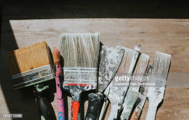 an array of various sized paint brushes and decorating equipment - table stock pictures, royalty-free photos & images