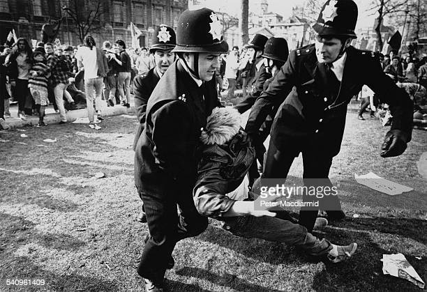An arrest during the Poll Tax Riots in London 31st March 1990