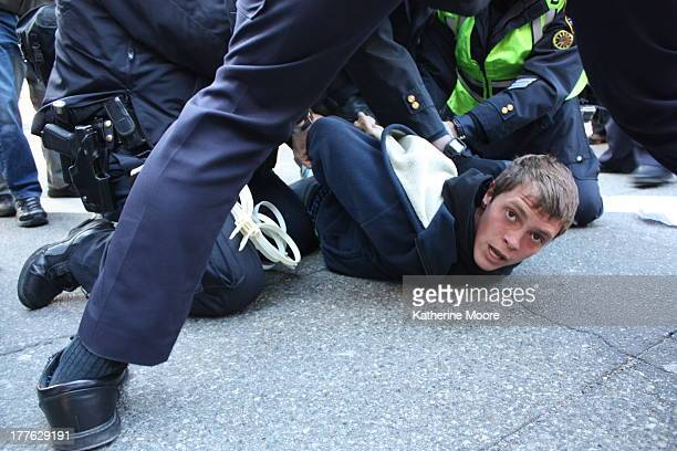 An arrest is made during the Move Your Money march