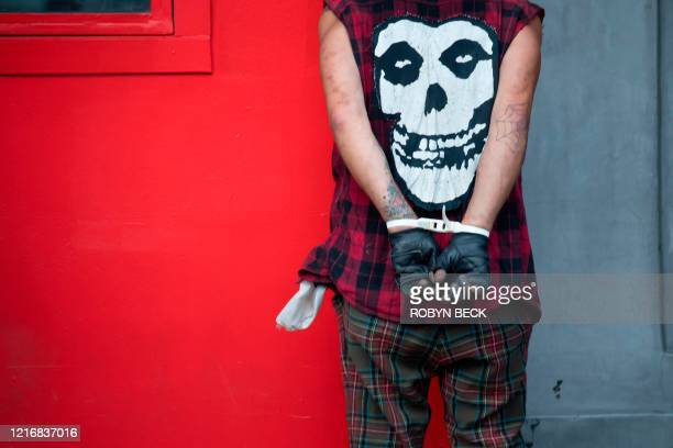 An arrested man is pictured in Hollywood California June 1 as a third night of curfews followed days of massive mostly peaceful protests to decry...