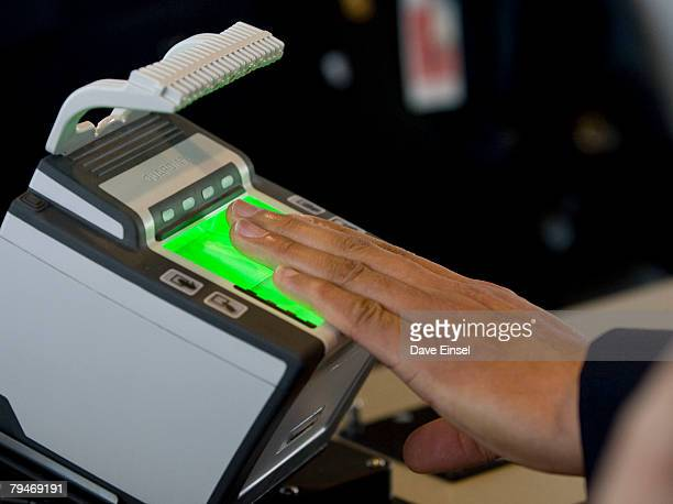 An arriving passenger uses a new biometric scanner at George H W Bush Intercontinental Airport February 1 2008 in Houston Texas The new system is set...