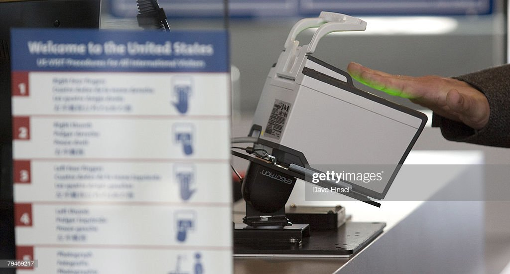 An arriving passenger uses a new biometric scanner at George H. W. Bush Intercontinental Airport February 1, 2008 in Houston, Texas. The new system is set up to scan all ten fingers instead of the two finger scanners previously used.