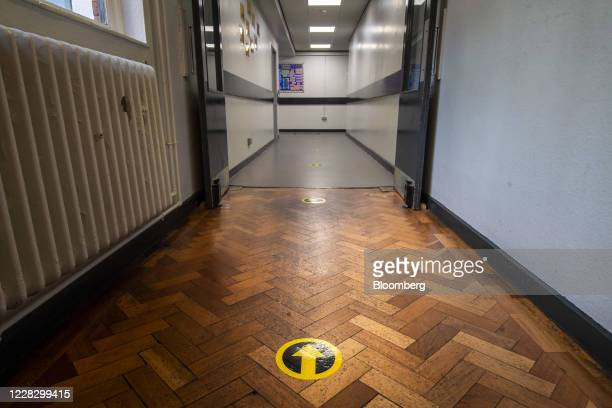 An arrow for directing the flow of school pupils sits in a corridor at All Saints Catholic College ahead of reopening for students in Manchester,...