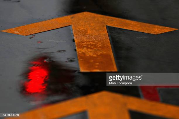 An arrow painted on the pitlane during final practice for the Formula One Grand Prix of Italy at Autodromo di Monza on September 2 2017 in Monza Italy