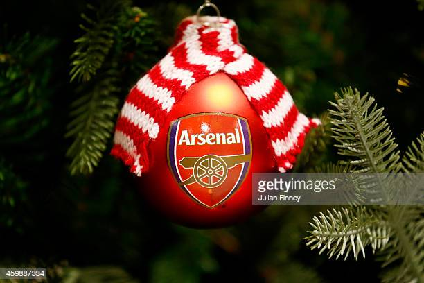 An Arsenal Christmas bauble hangs on a Christmas tree in the club store before the Barclays Premier League match between Arsenal and Southampton at...