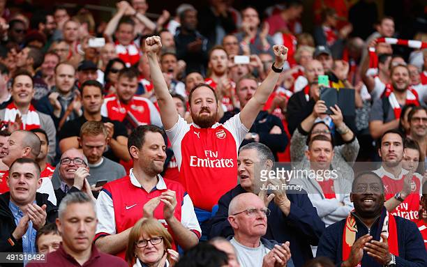 An Arsenal fan celebrates their win over Manchester United during the Barclays Premier League match between Arsenal and Manchester United at Emirates...