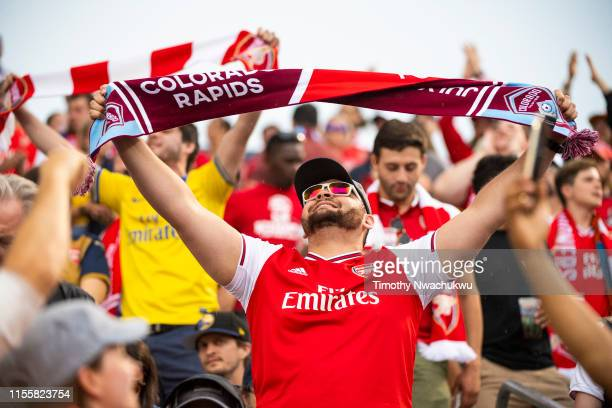 An Arsenal fan cheers at Dick's Sporting Goods Park on July 15 2019 in Commerce City Colorado