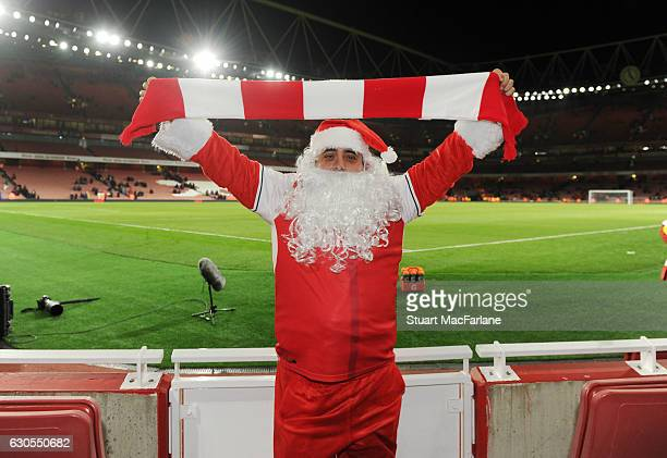 An Arsenal fan dressed as Father Christmas after the Premier League match between Arsenal and West Bromwich Albion at Emirates Stadium on December 26...