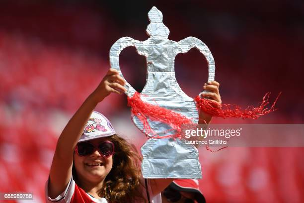 An Arsenal fan holds up a homemade FA Cup Trophy prior to The Emirates FA Cup Final between Arsenal and Chelsea at Wembley Stadium on May 27 2017 in...