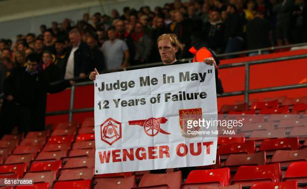 An Arsenal fan holds up an Arsene Wenger out protest banner during the Premier League match between Southampton and Arsenal at St Mary's Stadium on...
