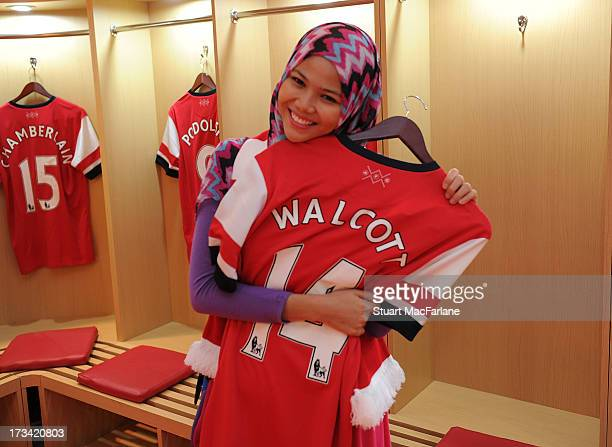 An Arsenal fan hugs Theo Walcott's shirt before a Fan Party in Indonesia for the club's preseason Asian tour on July 13 2013 in Jakarta Indonesia