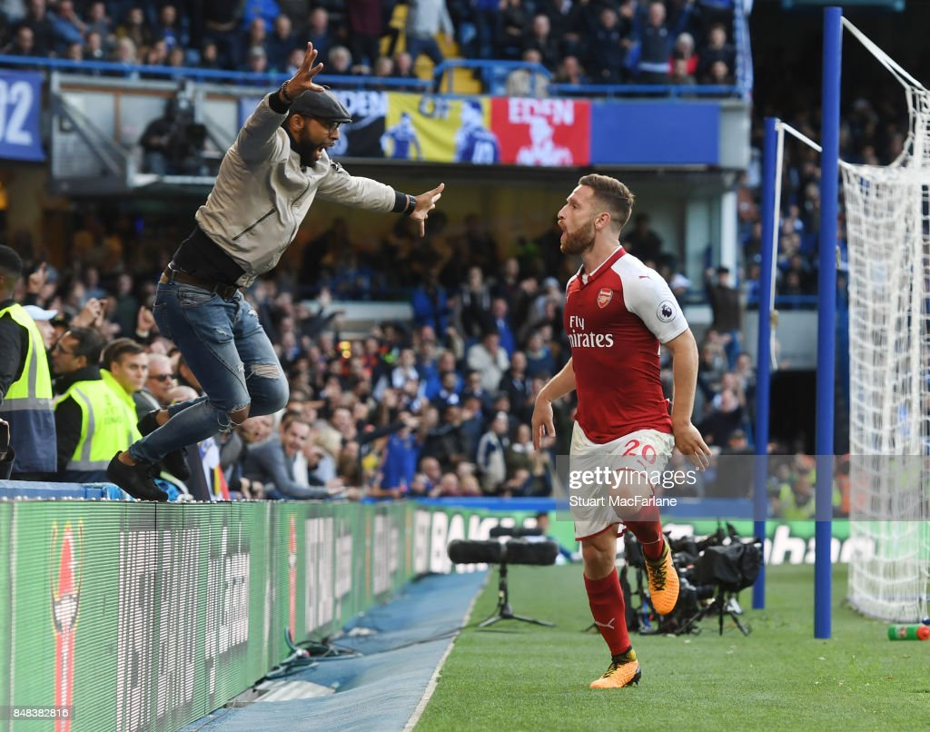 An Arsenal fan jumps onto the pitch as Shkodran Mustafi celebrates his goal which was disallowed during the Premier League match between Chelsea and Arsenal at Stamford Bridge on September 17, 2017 in London, England.