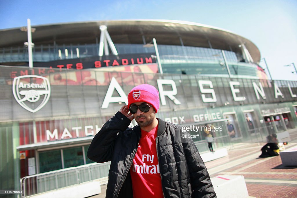 An Arsenal fan leaves the shop of Arsenal Football Club's Emirates Stadium on April 11, 2011 in London, England. American businessman Stan Kroenke's company 'Kroenke Sports Enterprises' has increased its shareholding in Arsenal to 62.89% and will make an offer for a full takeover of the club. Kronke first purchased 9.9% of Arsenal shares in 2007. Today's deal values the Premier League club at 731m GBP.