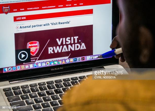 An Arsenal Fan Looks At The Website Of Englands Football Club That Shows Rwandas New