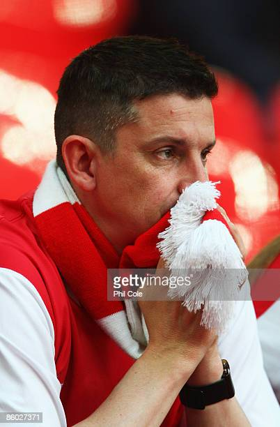 An Arsenal fan looks dejected after the FA Cup sponsored by EON Semi Final match between Arsenal and Chelsea at Wembley Stadium on April 18 2009 in...
