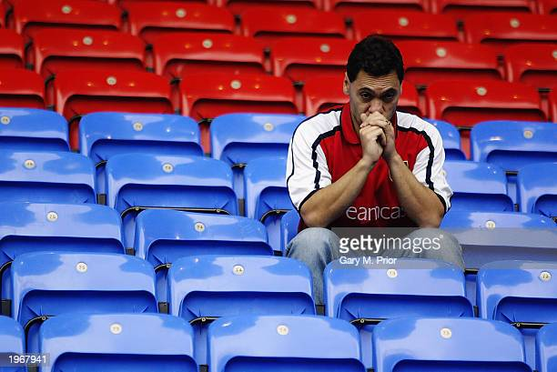 An Arsenal fan looks dejected during the FA Barclaycard Premiership match between Bolton Wanderers and Arsenal held on April 26 2003 at the Reebok...