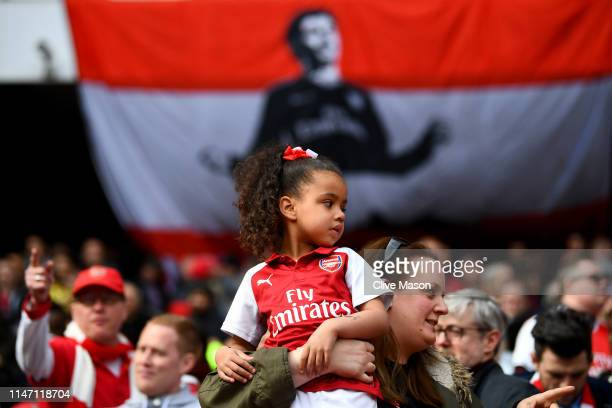 An Arsenal fan looks on during the Premier League match between Arsenal FC and Brighton Hove Albion at Emirates Stadium on May 05 2019 in London...