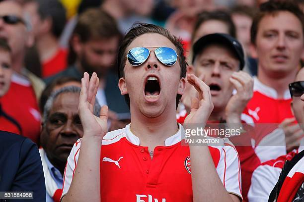 An Arsenal fan reacts at the final whistle following the English Premier League football match between Arsenal and Aston Villa at the Emirates...