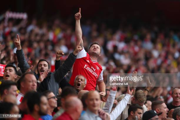 An arsenal fan shows his support during the Premier League match between Arsenal FC and Tottenham Hotspur at Emirates Stadium on September 01 2019 in...
