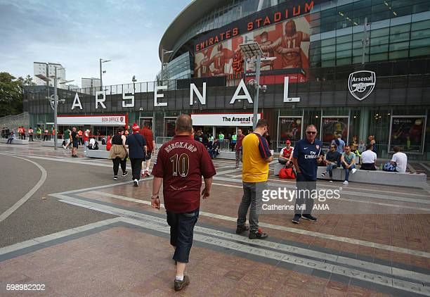 An Arsenal fan wearing a Dennis Bergkamp shirt arrives at the stadium before the Arsenal Foundation Charity match between Arsenal Legends and Milan...