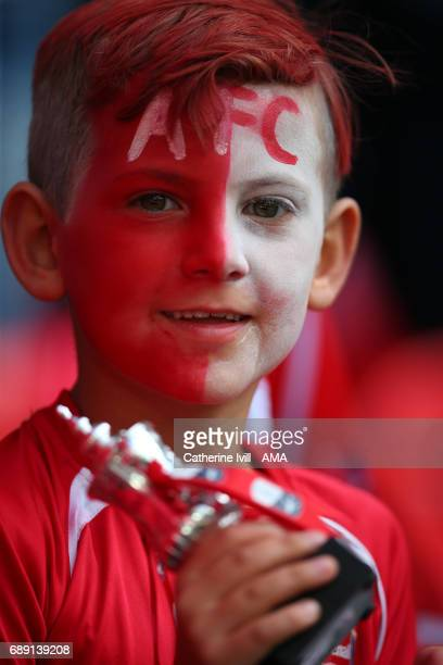 An Arsenal fan with a painted face and miniature FA Cup trophy during the Emirates FA Cup Final match between Arsenal and Chelsea at Wembley Stadium...