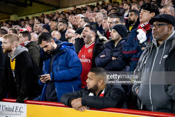 An Arsenal fan yawns during the Premier League match between Sheffield United and Arsenal FC at Bramall Lane on October 21 2019 in Sheffield United...