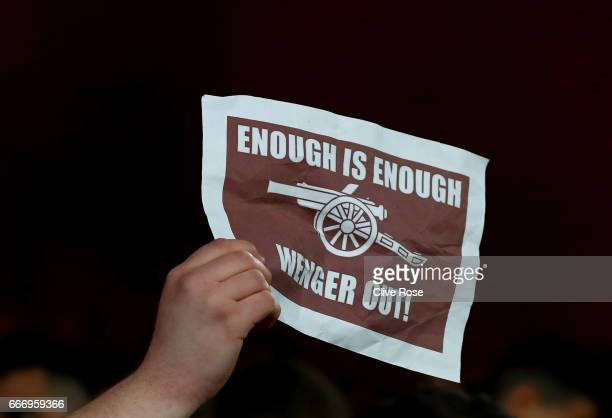 An Arsenal fans holds a protest sign after defeat in the Premier League match between Crystal Palace and Arsenal at Selhurst Park on April 10 2017 in...
