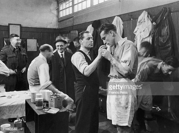 An Arsenal player receiving smelling salts from the trainer in the changing room at White Hart Lane April 1946 Arsenal defender George Male is...