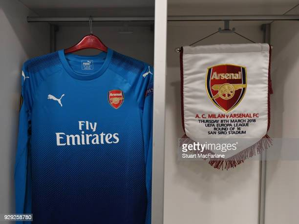 An Arsenal shirt and match pennant hang in the changing room before UEFA Europa League Round of 16 match between AC Milan and Arsenal at the San Siro...