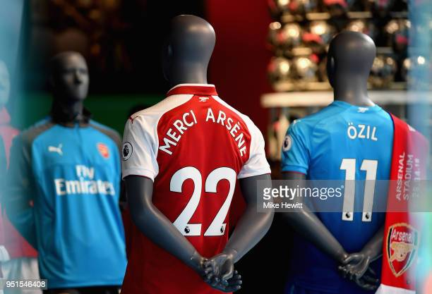 An Arsenal shirt showing thanks to Arsene Wenger is sold inside the club shop prior to the UEFA Europa League Semi Final leg one match between...