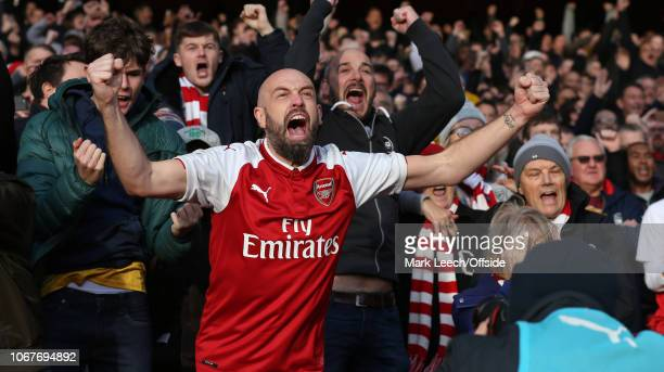An Arsenal supporter celebrates a penalty kick taken by PierreEmerick Aubameyang of Arsenal during the Premier League match between Arsenal FC and...