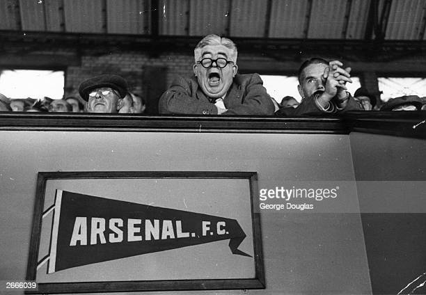 An Arsenal supporter yawns during a match between Arsenal and Glasgow Rangers at Arsenal's Highbury Stadium London Original Publication Picture Post...